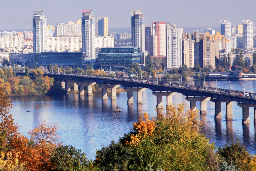 Ukraine Bridge Over Water with City Background