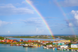 Antigua and Barbuda Rainbow Over Water and Houses